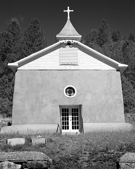 A mission church stands in brilliant morning sun in the Peco WIlderness.