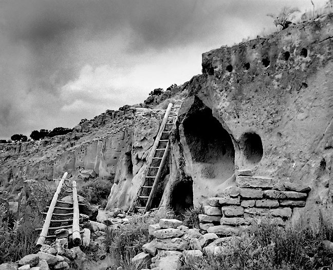 A thunderstorm approaches the face of the Puyé Cliff Dwellings in central New Mexico.