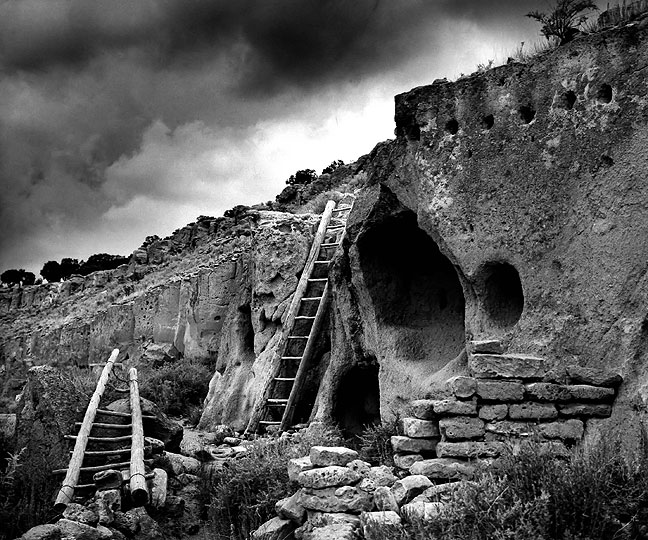 Ladders and approaching storm, Puyé Cliff Dwellings