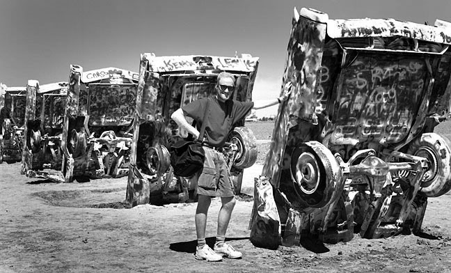 Your host poses at Amarillo's Cadillac Ranch on the road to Villaneuva.