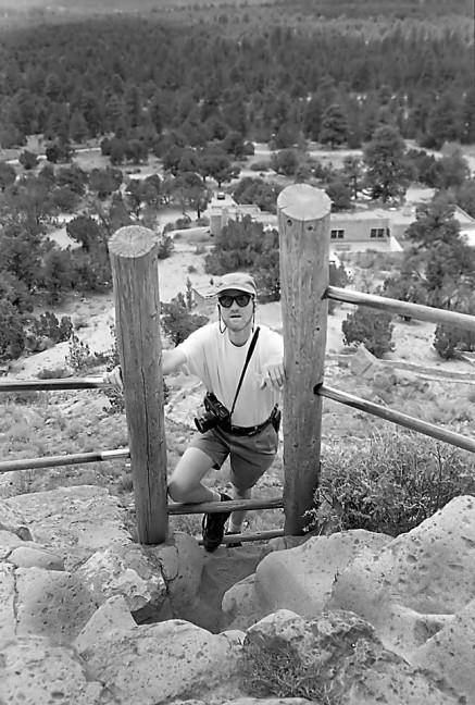 This is me climbing a short ladder at Puyé Cliff Dwellings. Note my Fuji 6x7 medium format camera.