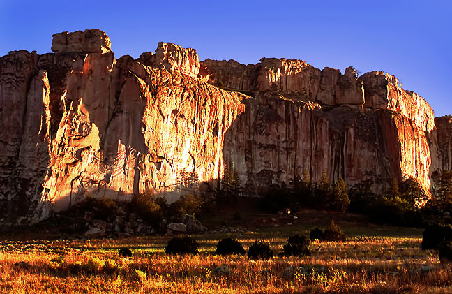 The cliffs of Inscription Rock stand in late afternoon light at El Morro National Mounment, New Mexico.