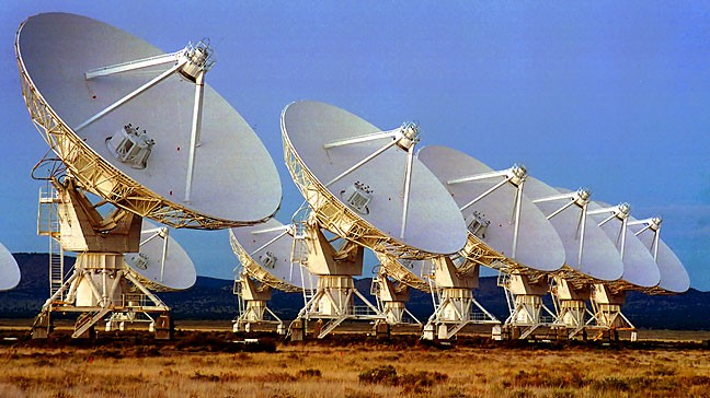 Dishes of the Very Large Array radio telescope begin to pick up early evening light.
