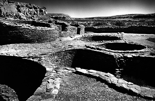 Clear midday sun rains down on the Pueblo Bonita great house at Chaco.