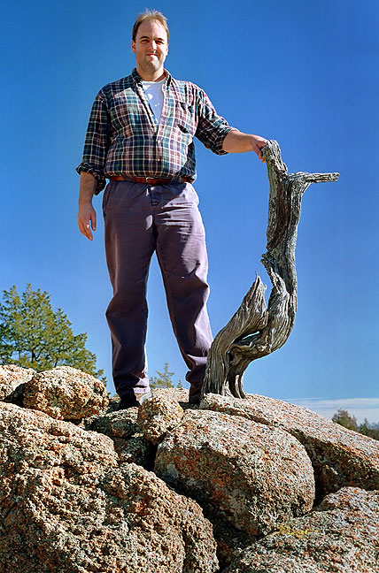 Frequent hiking partner David Martin poses with a piece of deadwood near Bat Cave Mountain in 1995.
