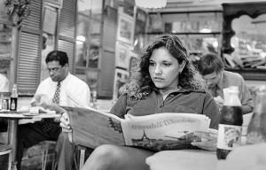 Ann reads a paper at Weaver's Po Boy.