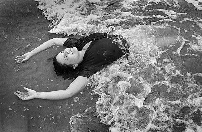 Ann lays in the surf at Grand Isle State Park.