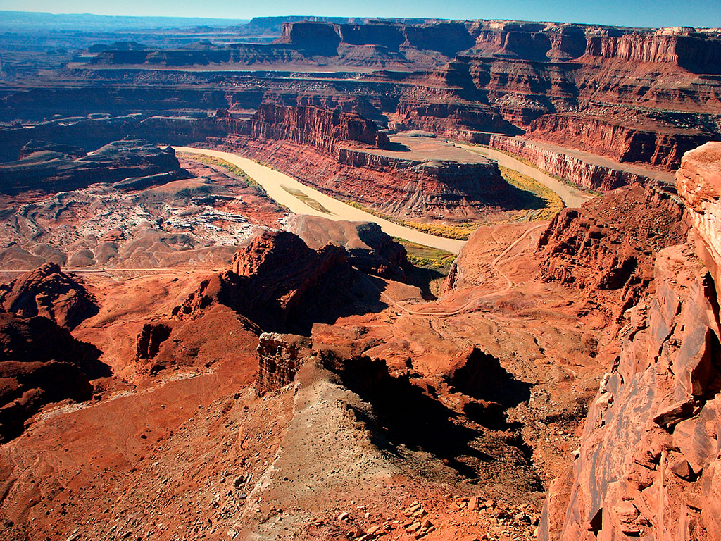 This wider view from Dead Horse Point shows the panoramic potential of the vista. Beyond the river is the Island in the Sky district at Canyonlands.
