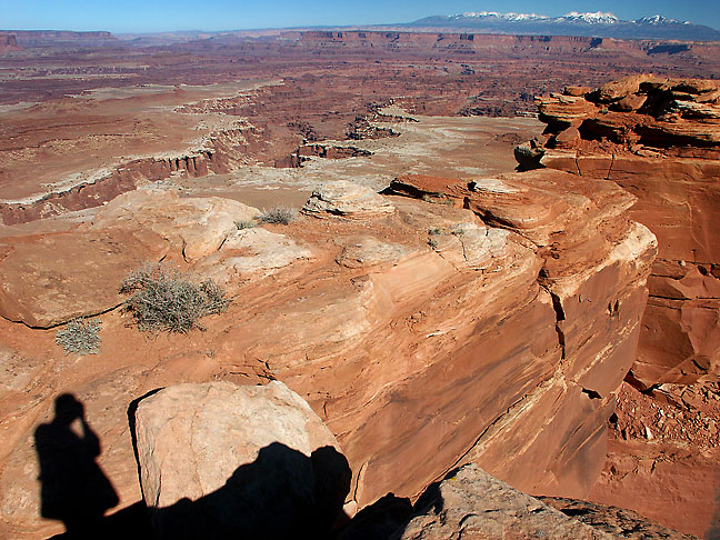 This view looks east from the White Rim Overlook, with the La Sal Mountains in the distance.
