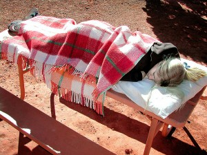 Another nap; Jamie sleeps on a picnic table while David and I explore the White Rim Overlook at Canyonlands.