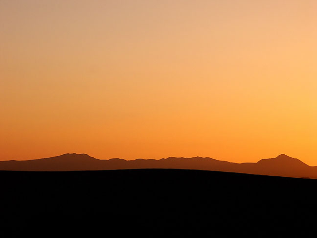 Looking west from Guadalupe Mountains National Park at distant mountains, sunset.