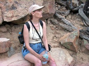 Abby takes break for some water as she and I climb the indistinct trail leading to La Ventana Natural Arch.