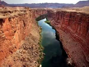 This view looks north up the Colorado river from the Navajo Bridge, which flows through Marble Canyon.