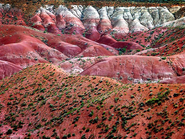 Part of Petrified Forest National Park, the Painted Desert is seen here in light muted by smoke from nearby wildfires.