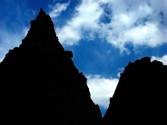 Kasha-Katuwe Tent Rocks National Monument formations are silhouetted against the afternoon sky.