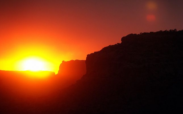 The sun sets brilliantly in Tsegi Canyon near Kayenta, Arizona.