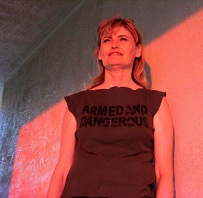"Abby watches the sun go down in Santa Fe, wearing her ""Armed and Dangerous"" shirt."