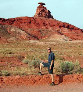 The author poses for a photo at the namesake rock in Mexican Hat, Utah.
