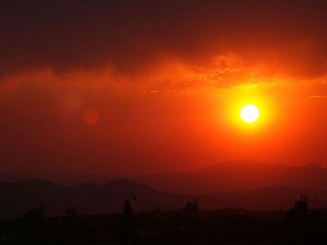 The sun sets on Santa Fe, New Mexico.
