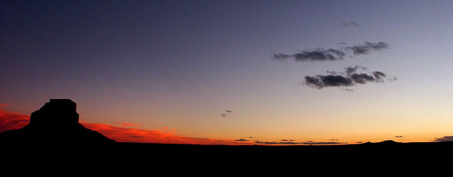 The signature formation of Chaco Canyon, Fajada Butte, and a cold desert sky after sunset, are visible in this view made near the Visitor Center.