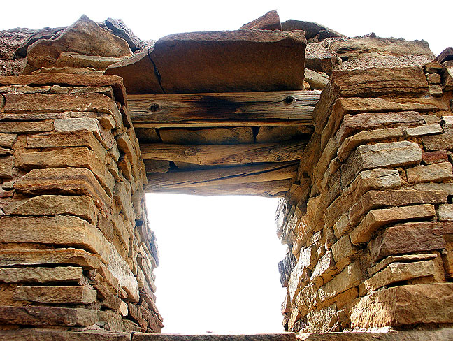 Cold light streams through a masonry window at the Peñasco Blanco Great House at Chaco Canyon.