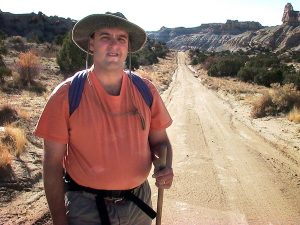 David poses for a photo on a gas well access road at the bottom of the slopes below Angel Peak.