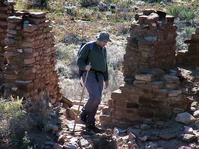 David prowls the partially-excavated ruins of the Tsin Kletsin Great House.