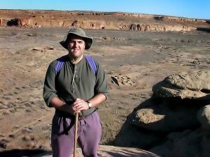 David poses at the top of the canyon rim above Casa Rinconada.