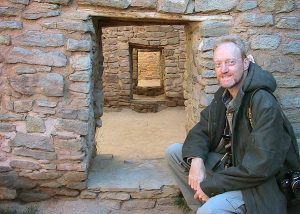 Your host poses at a doorway at Aztec Ruins National Monument.