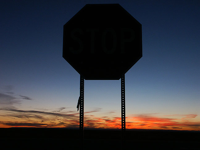 Stop sign at sunset, northwest New Mexico.