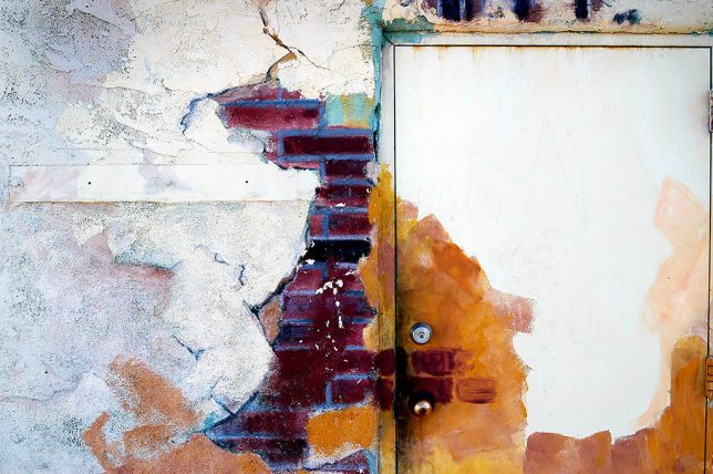 While having lunch in Albuquerque, we spotted and photographed this artistically-rendered wall and door.