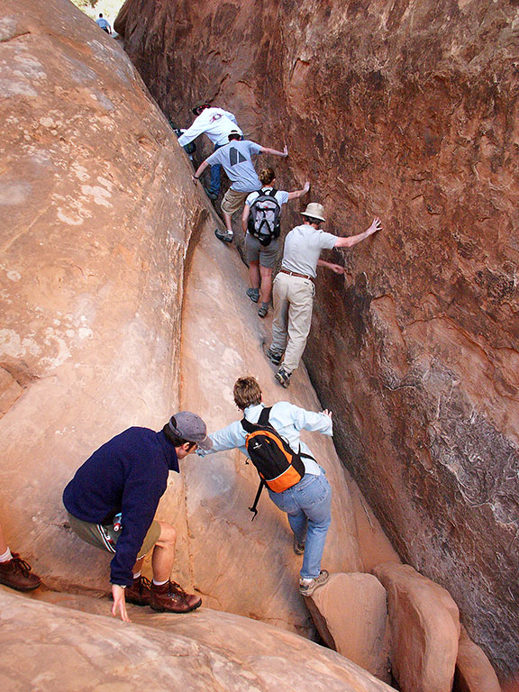 Members of our Fiery Furnace tour group funnel into a fissure as we make our way to Surprise Arch.