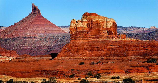 Wooden Shoe Butte and Sixshooter Peak are visible in this sunset image at The Needles district of Canyonlands.