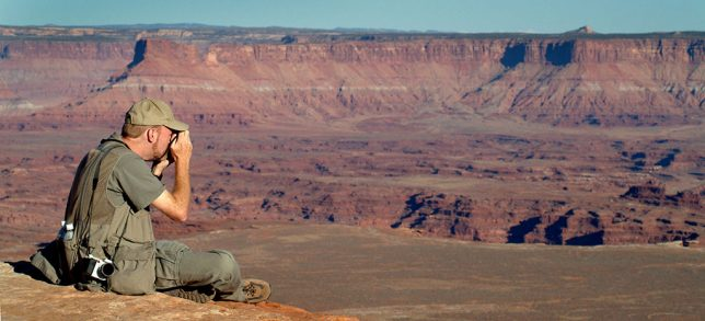 Your humble host photographs Canyonlands from Grand View Point as sunset approaches.