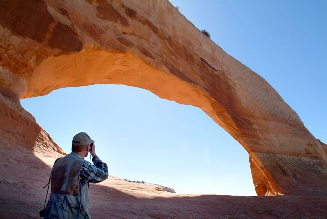 Your host photographs Wilson Arch on our drive to Moab, Utah.