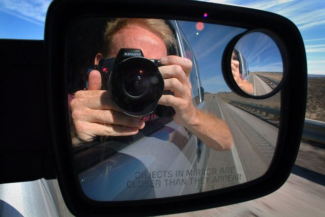 Your host makes a self portrait in the mirror of Michael's Honda Element as we make the long drive home to Oklahoma.