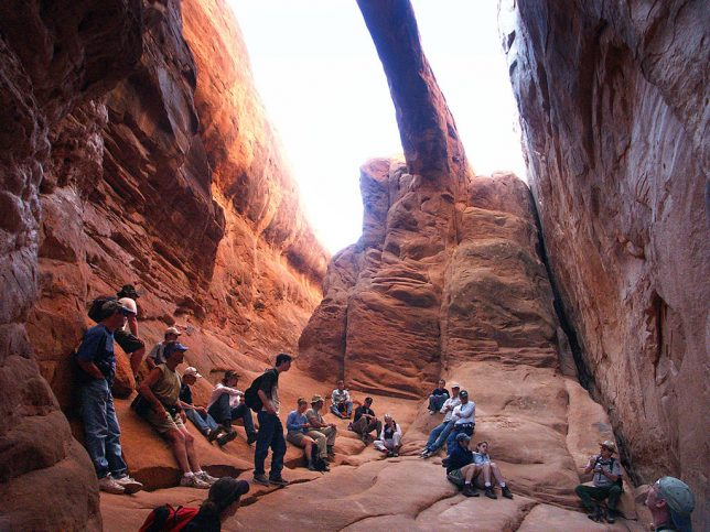 Our Fiery Furnace tour group stops to marvel at Surprise Arch.