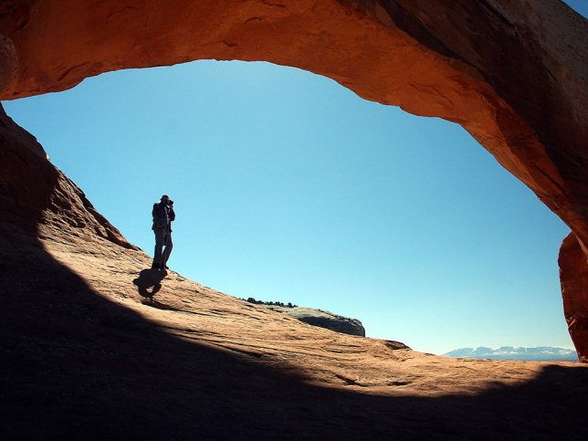 Michael makes images from inside Wilson Arch on the highway south of Moab, Utah.
