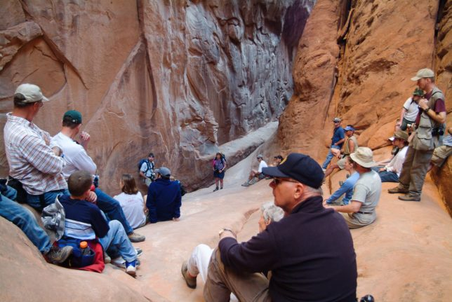 Your host is visible on the far right side of this image at Surprise Arch in Arches National Park.