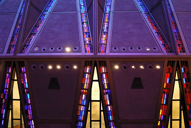 The Air Force Academy Chapel's stained glass collects morning light in this interior view.