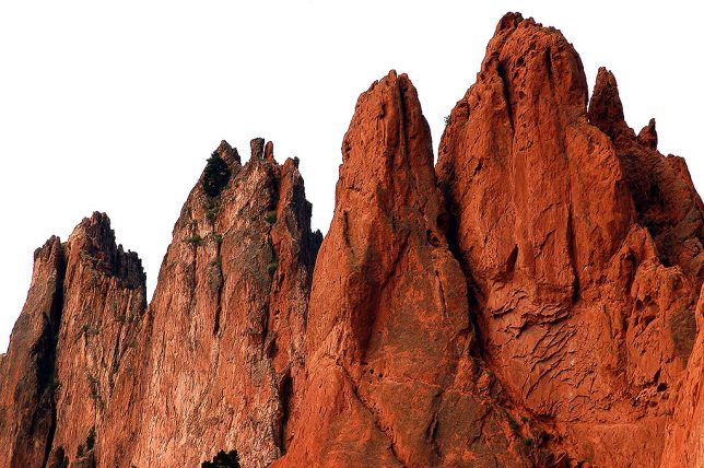 Peaks of Garden of the Gods stand against a bright sky.