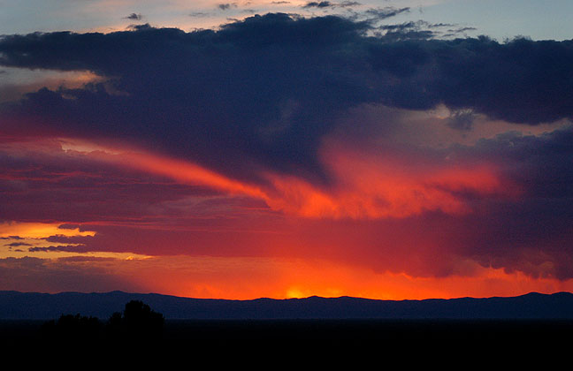 Clouds turn deep red and orange after sunset in the San Luis Valley of south-central Colorado.
