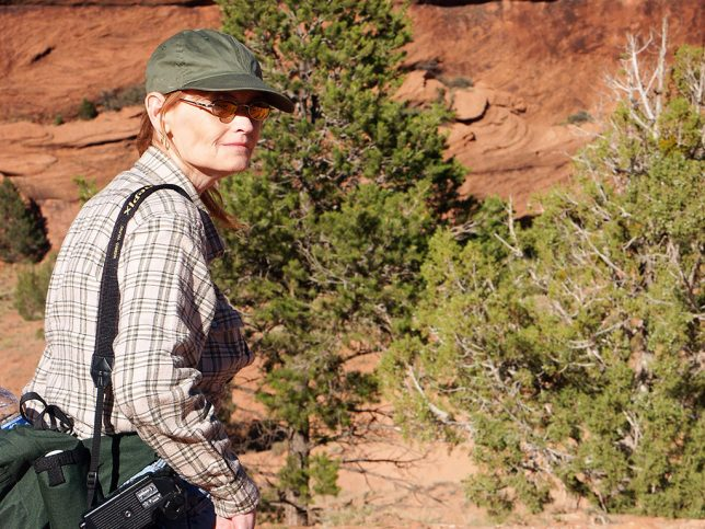 Abby surveys Canyon de Chelly for photo opportunities.