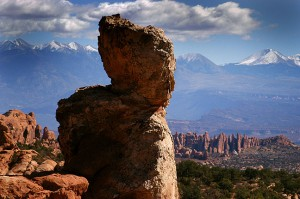 Spire near the Dark Angel formation, with the La Sal Mountains in the distance.