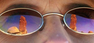 The Dark Angel spire, at the end of a spur trail on Arches' Primitive Loop trail, is shown in Abby's sunglasses.