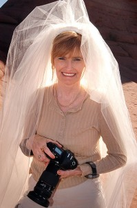 Abby holds her camera moments after the wedding ceremony.