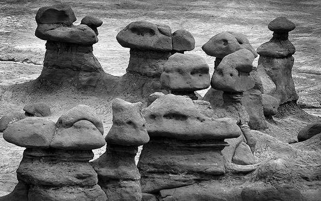 The unusual stone shapes in Goblin Valley result from the weathering of Entrada Sandstone.