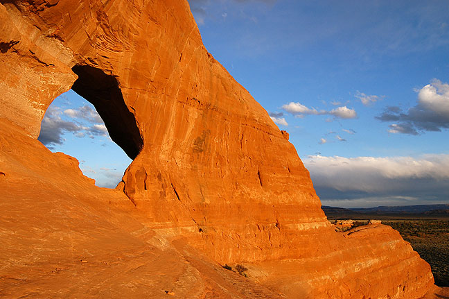Looking Glass Rock is a handsome natural arch along U.S. 191 south of Moab, Utah, shown here at sunset.