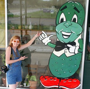 Abby poses at The Chubby Pickle on a roadside in Kansas.