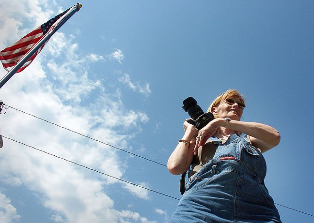Abby smiles as she photographs Main Street in Cawker City, Kansas.